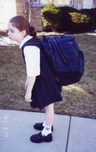 This poor little girl is so weighted down by her backpack that she looks like a Himalayan Sherpa! (courtesy of  spineuniverse.com)